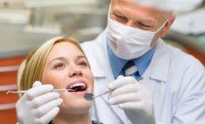 стоматолог зуб